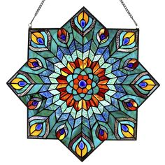 This geometric, peacock inspired stained glass window panel is sure to capture eyes in any space! The center of the panel features a petal-like design sprouting from a bold blue cabochon. As you make your way to the edges of the panel, you run through rich red striated glass, blueish-green ripple glass into a pattern with a mix of striated and ripple glass in the design of a peacock feather made from 265 glass cuts and cabochons. Let the light shine through this piece and bring joy and…