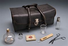 Nurse's Bag and Contents. L'Hôpital du Sacré-Cœur, Montreal, 1947. This #nurse's bag contains vials, hypodermic needles, thermometer, scissors, beakers, carafe and burner (for sterilizing needles) and religious medals. This collection also includes her cap, certificates, licence and textbooks.