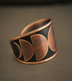 Copper moon phase cuff by HouseOfTenebris on Etsy
