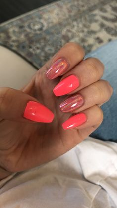 Bright pink nails with holographic feature nails.