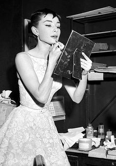 Original caption: Audrey Hepburn, Dutch born darling of American film, won a coveted Oscar for the Best Performance by an Actress. The lovely 22 year old actress hit the jackpot with her first American film, Roman Holiday. Here, she is shown in the dressing room of the Center Theater, where she changed after coming from the 46th Street Theater, where she was appearing in Ondine.