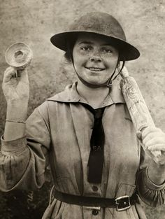"""1918 WWI - Stella Young, a """"Doughnut girl"""" holding a rolling pin and donut mold. Salvation Army Lassie"""