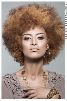 One word...beautiful. To learn how to grow your hair longer click here - http://blackhair.cc/1jSY2ux