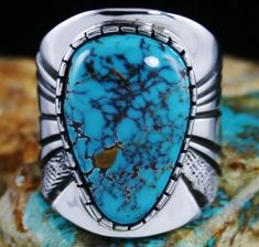 Leonard Nez Danny Boy Spiderweb Ring #LeonardNez This marvelous ring features Leonard's signature thick and heavy ten gauge sterling silver shank. The shank is deeply stamped with clean lines and textured on either side. A beautiful large gem grade natural Danny Boy turquoise is set in a hand chiseled bezel. The gem is a superb representation of the mine, deep blue with fine dark reddish-brown webbing exhibited in layers. Ring Size: 9-1/2