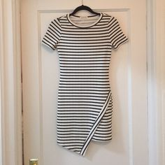 Asymmetrical stripe dress Fitted asymmetrical hem dress. Has a nice stretch and very flattering fit.  Necessary Clothing Dresses Mini