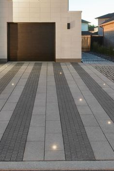 This modern driveway landscape was created using the combination of Squardra and Industria. Creating the perfect driveway will surly enhance the value of your home and ake a greate first impression when guests come over! Want to start building your dream space? Click this pin! Modern Driveway, Driveway Design, Driveway Landscaping, Landscaping Ideas, Landscape Design, Garden Design, Pavement Design, Paving Ideas, Paving Design