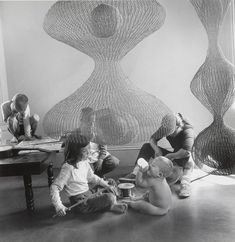 """Photo of contemporary sculptor Ruth Asawa (at right rear) – a.k.a. San Francisco's """"fountain lady"""" – at work with children in 1957 by Imogen Cunningham, gelatin silver print from the collection of the Museum of Modern Art (MoMA), NY. Asawa died at the age of 87 on August 5, 2013. See the tribute by San Francisco Chronicle art critic Kenneth Baker: http://bit.ly/1bKflas Ruth Asawa, Wire"""