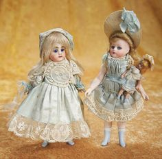 "Theriault's - 6"" All-Bisque Mignonette for the French Market with Fancy Blue Bow Ankle Boots, c 1890; French All-Bisque Mignonette with Unusual Expression, Original Costume, Carries An All-Bisque Swivel Head Tiny Doll with Blue Ankle Boots and Original Costume, c 1882"