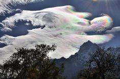 Heavenly haze: Remarkable rainbow cloud towers over Mount Everest Good.