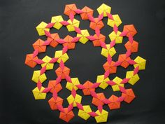 Pentagons with Slits joined on Side Origami Quilt (front side) by Stephen's Origami, via Flickr