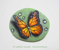 Reserved for Shane. Stone Painting Monarch Butterfly with Dew Drops! Is Painted with Acrylic paints and finished with Glossy varnish.