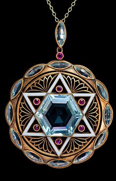 Vintage jewish jewelry - Star of David - Magen David necklace-A Vintage Art Deco Star of David Pendant An original pre World War II Art Deco pendant designed as a round openwork matte gold plaque  with a white enamel Jewish six pointed Star of David set with a hexagonal aquamarine and six small rubies.  Maker's initials ' W C L ' are engraved in two places on back. European, circa 1930 $8,500.00