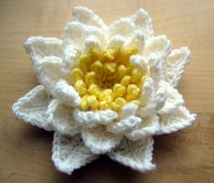 Water Lily crochet pattern on the page with  links all the end of the patter to both pdfs in both Us and UK terms.