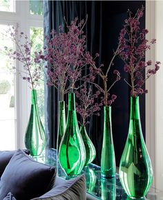 Another Ken Marten design using colored vases and purple stems.