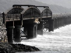 The longest wooden bridge in Europe in Barmouth, Wales. Situated just a stone's throw from Farchynys Hall. Wales Uk, North Wales, British Seaside, British Isles, Snowdonia National Park, Far Away, Great Britain, Cool Places To Visit, Trains