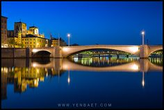 Saint Jean's Cathedral and Pont Bonaparte on the Saône River - Lyon, France.    One of the oldest bridges of Lyon, the Bonaparte bridge connects the west to the right bank of the Saône. From the embankment before the bridge there is a fine view of St.