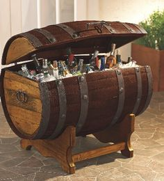This reclaimed 60 gallon French Oak wine barrel has been converted and refinished into a massive ice chest that can hold up to 100 pounds of ice, beer, sodas, and whatever else you can cram in that needs to stay chilled.