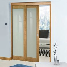 Deanta Twin Telescopic Pocket Walden American Oak Veneer Doors - Frosted Safety Glass - Unfinished.    #pocketdoors  #glazedoakdoors  #telescopicpocketdoors