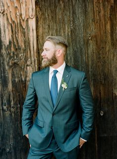 Handsome groom.  Stellar suit.  Glorious beard.  You can't ask for more than that!  Shot on Kodak Portra 400 medium format film.  More from their big day at http://www.sarahmaren.com/rustic-sacramento-outdoor-wedding  Sarah Maren Photography Sacramento, California Available world wide
