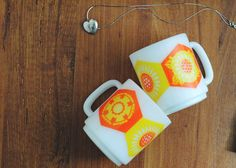 cheery vintage mugs + heart locket found at the thrift store