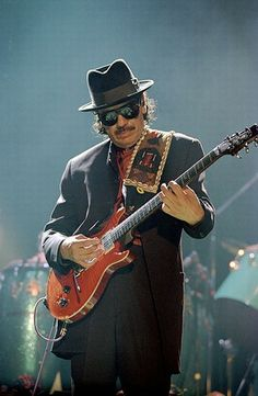 Smooth Carlos Santana -While my guitar gently weeps - http://www.clipfish.de/musikvideos/video/3451403/santana-while-my-guitar-gently-weeps/