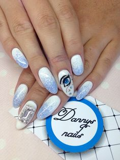 White nails with blue eye design