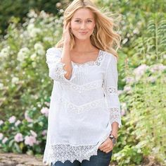 """Cobwebby crochet lace bands neckline, sleeves, body and hem of our dotted swiss cotton lawn tunic, as pretty and feminine as can be. Square neck, pintucks front and center. Hand wash. Imported. Exclusive. Sizes 2 to 16. Approx. 30""""L."""