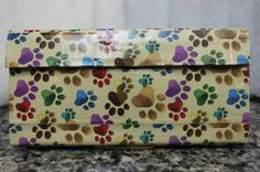 Duct Tape Wallet (Clutch) - Paw Prints, $18.      We are also on Etsy at:  www.junorduck.etsy.com.