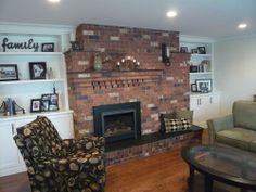 Red Brick Fireplace, Black Slate Hearth, White Cabinets and Bookshelf