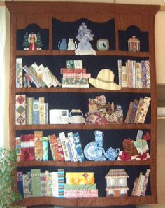 Bookcase quilt, side 2.  Owner says: This was a 'sew a row' round robin with my local group, and I asked for 'shelves' made from designs in a book called 'The Collectibles Quilt' . I got so many shelves back that I had to make a double-sided quilt out of them.