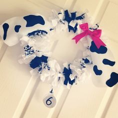 Black and white wreath at a Puppy Dogs Birthday Party!  See more party ideas at CatchMyParty.com!