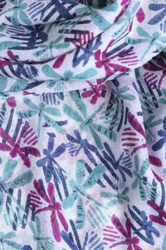 Our new Dragonfly Scarf is simply a pretty, lightweight scarf perfect for accessorising any outfit. The super easy to style piece features a range of blues, greens and pinks, finishing with a stitched floral trim.   100% Woven