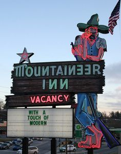 """With a Touch of Modern"" #toofunny  Asheville icon  Mountaineer Inn on Tunnel Road, Asheville, NC."