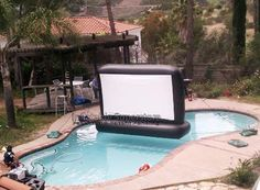 Inflatable Backyard Movie Screen - Pool parties are some of the best parts about enjoying the warm, summer season, and this ultra cool inflatable backyard movie screen is offering up. Backyard Movie Screen, Pool Movie, Inflatable Movie Screen, Pool Accessories, Pool Floats, Lake Floats, Swimming Pools Backyard, Swimming Pool Toys, Dream Pools
