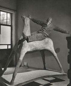 Marino Marini in his studio on one of his horses (Milan, Italy 1952.) Photo by Herbert List