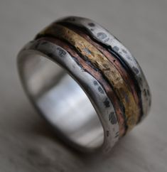 mens wedding band - rustic fine silver copper and brass - handmade artisan designed wide band ring - manly ring - customized. $275.00, via Etsy.
