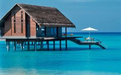 ONE & ONLY REETHI RAH IN THE MALDIVES Many of the property's high-end villas hover over the lagoon, but are tastefully tropical: coconut-shell sconces, bamboo arches. Days are best spent on one of 12 secluded beaches, or in one of the spa's overwater treatment rooms. Come nightfall, take to a hammock for the uninterrupted stargazing.