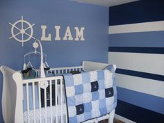 "Nautica Nursery, My husband loves sailboats so the perfect nursery for our new son included the bedding set ""William"" from Nautica. I used the colors from the set to do an accent wall in vertical stripes. Very time consuming but very worth it., Nurseries Design"
