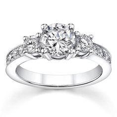 <li>Round-cut diamond engagement ring</li><li>18-karat white gold jewelry</li><li><a href='http://www.overstock.com/downloads/pdf/2010_RingSizing.pdf ' target='_blank'><span class=links>Click here for Ring Sizing Chart</span></a></li>