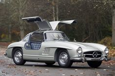 Alloy body 1955 ultra rare 300SL.  Note plaid interior the race cars of the age had them so you had to have one also.