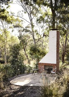 Chimney designed by Kennedy Nolan Architects. Similar garden / fireplace area