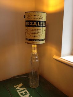 Esso lube bottle with an old tin combined to make this quirky and original lamp, they don't sell these in bhs!