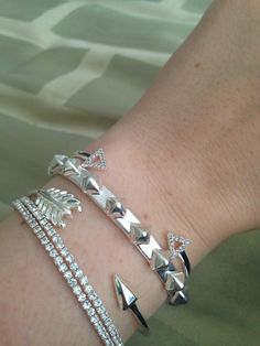 Silver arm party with the pyramid studded cuff, the arrow bangle, the radiance coil, and the pavé arrow cuff!  Shop at stelladot.com/patriciagraham