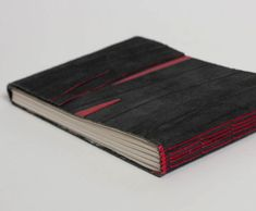 Diary bound in smooth leather strap with red elements. Long Stitch Binding.  Circulation: 1. From Bookbindery Wilgenkamp