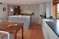 Quarry tiles, blue kitchen, white surface. Works in a period kitchen