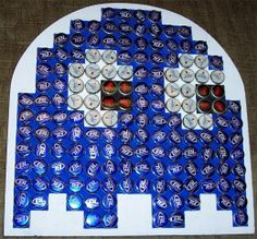 Bottle caps! I am so doing this for the bar next to our old arcade game of pac man.. .Already strated saving the bottle caps :)