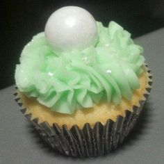 Pretty pastel green buttercream icing! Gumball is vanilla.
