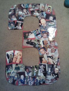 #3- Decoration for Boy's 3rd Birthday.  Large cardboard cut out decorated with pictures from birth to age 3.