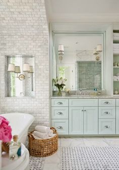 minty cabinets, marble, touch of pink, and a woven basket for warmth
