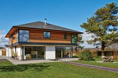 Contemporary self build home with upper storey cantilever and corner glazing